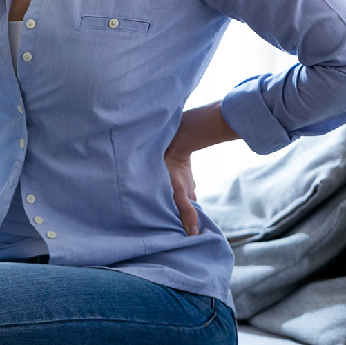 Pain Management Jacksonville FL Woman Suffering from Back Pain
